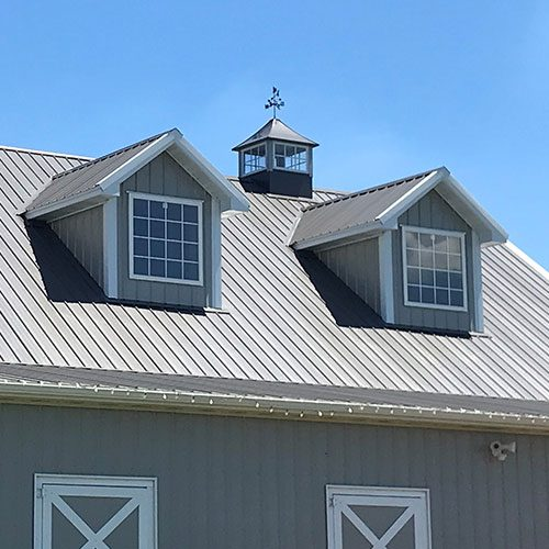 cape cod metal roof with cupola