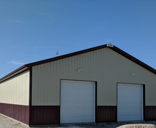 new white and red post frame barn