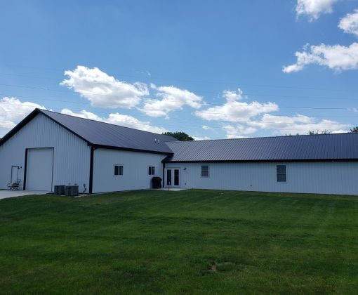 large white and black metal residential barn home